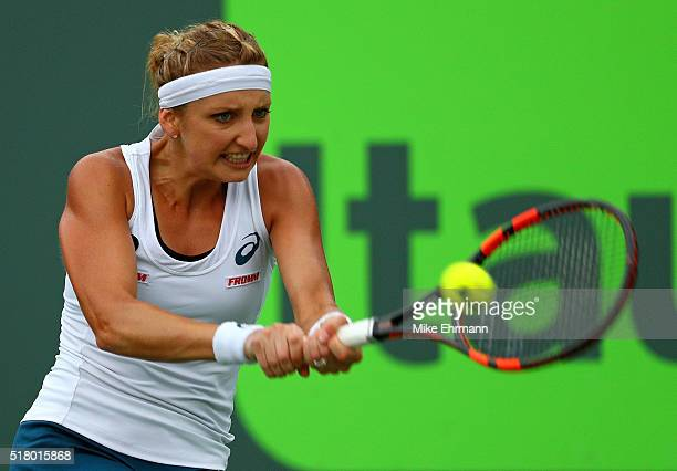 Timea Bacsinszky of Switzerland plays a match against Simona Halep of Romania during Day 9 of the Miami Open presented by Itau at Crandon Park Tennis...