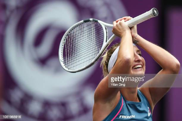 Timea Bacsinszky of Switzerland reacts after winning match point during the singles quarter final match against Aryna Sabalenka of Belarus on Day 5...