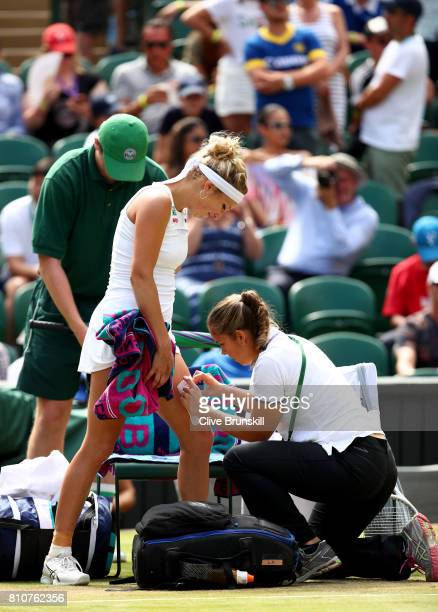 Timea Bacsinszky of Switzerland receives treatment from the medical team during the Ladies Singles third round match against Agnieszka Radwanska of...