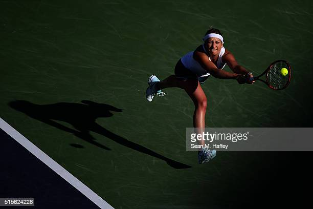 Timea Bacsinszky of Switzerland returns a shot against Eugenie Bouchard of Canada during the BNP Paribas Open at the Indian Wells Tennis Garden on...