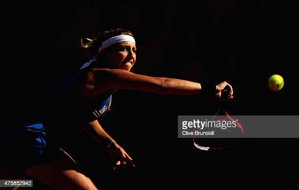Timea Bacsinszky of Switzerland returns a shot in her Women's Semi final match against Serena Williams of the United States on day twelve of the 2015...