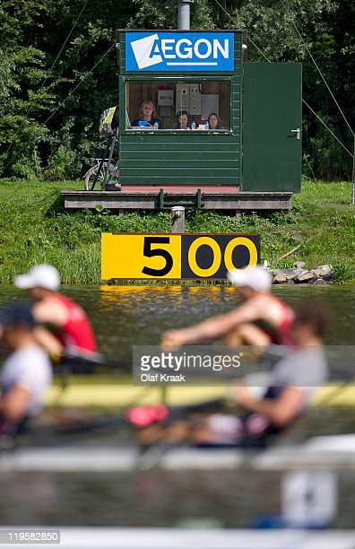 Timekeepers at the 500 meter point watch the Men's Double Sculls during Day Three of the FISA World Rowing Under 23 Championships 2011 on the Bosbaan...