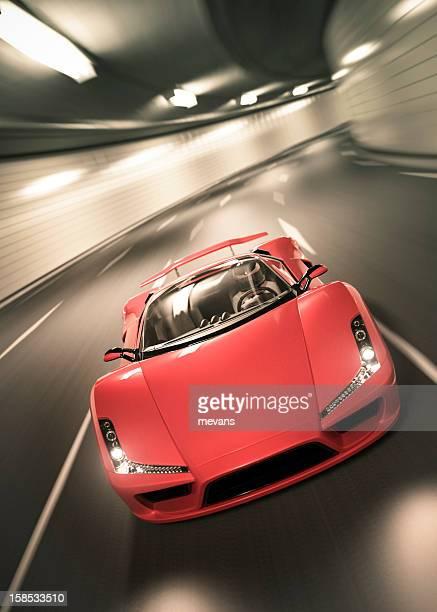 Time-lapse photo of red Lamborghini speeding at tunnel