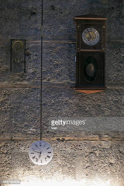 Time-passing On A Group of Clocks Decorated on a Old Stonewall