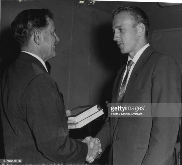 ED Timermanis of Quantas being presented the Hudson Fyshe prize by Mr Harold Affleck September 12 1957