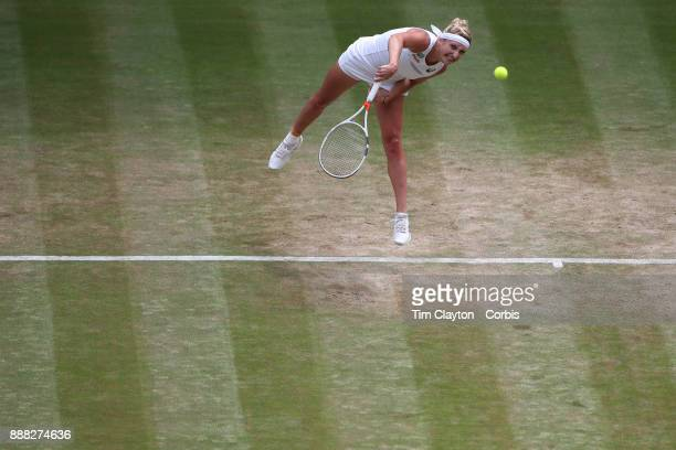 Times Bacsinszky of Switzerland in action against Agnieszka Radwanska of Poland on Centre Court during the Wimbledon Lawn Tennis Championships at the...