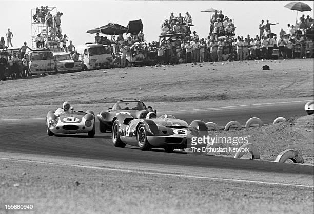 Times Grand Prix Riverside Bruce McLaren in his McLaren Elva Mk1 leads a group of cars coming out of a corner