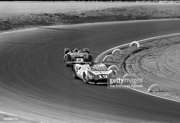 Times Grand Prix Riverside Dan Gurney leads Bruce McLaren in the corner Gurney driving his Ford powered Lotus 19B while Bruce is in his McLaren Elva...
