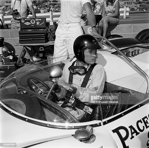 Times Grand Prix Riverside Dan Gurney sits in his Lotus 19B in the pits