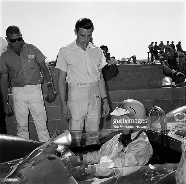 Times Grand Prix Riverside Jim Clark stands in the pits by Lotus teammate Mike Spence