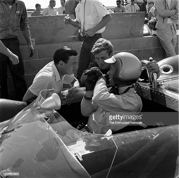 Times Grand Prix Riverside Jim Clark talks to his Lotus teammate Mike Spence in the pits