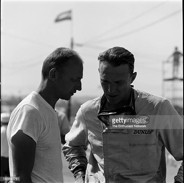 Times Grand Prix Riverside Race winner Parnelli Jones from Shelby American racing talks to Dan Gurney of Pacesetter Homes
