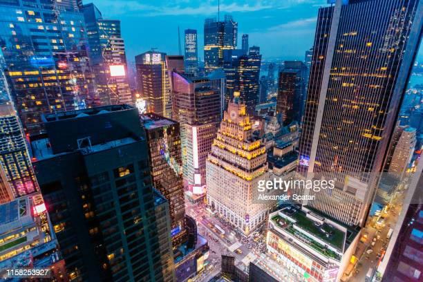 times square aerial view at night with illuminated skyscrapers, new york, usa - broadway manhattan - fotografias e filmes do acervo