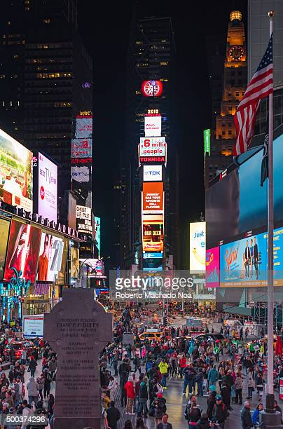 Times Square at night in New York City Times Square is a major commercial intersection and neighborhood in Midtown ManhattanThe landmark is brightly...