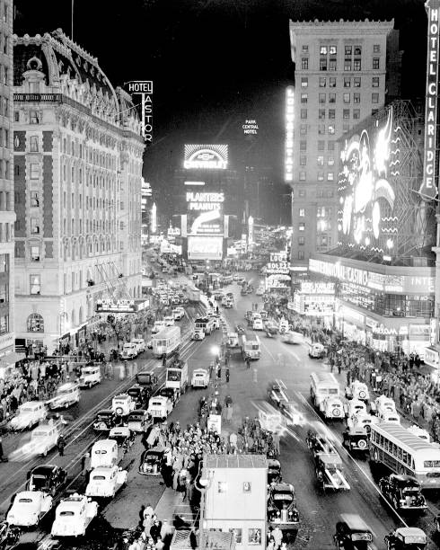 Times Square at night is a vision of lights and traffic.