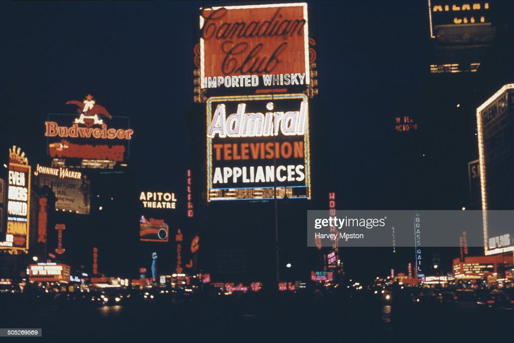 Times Square at night, showing advertisements for Canadian Club whisky, Admiral television appliances, Budweiser beer etc, New York City, USA, circa 1970.