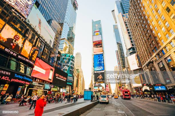 times square at sunset, manhattan, new york city, usa - broadway manhattan stock photos and pictures