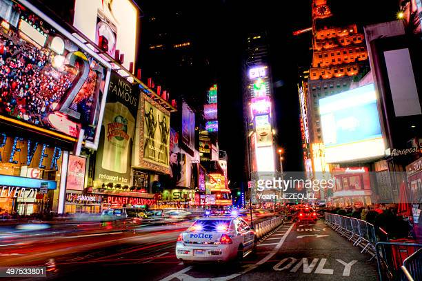CONTENT] Times Square by night New York City police car and people
