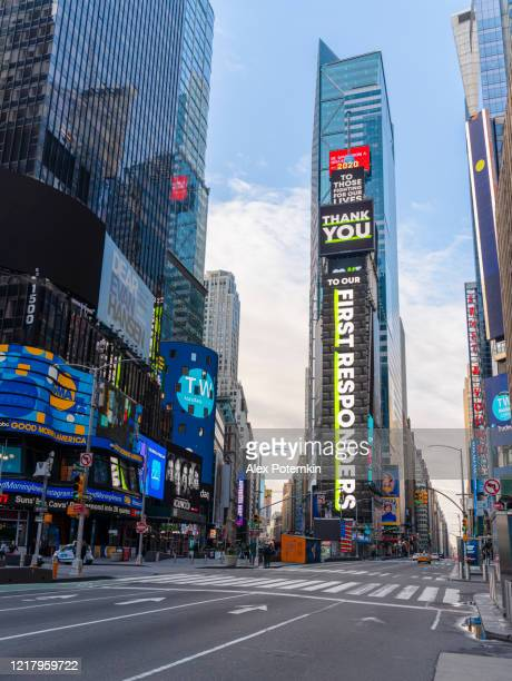 times square commercials on the main plaza display are now replaced with social advertising influenced by covid-19 pandemic outbreak, thanking first responders. - alex potemkin coronavirus stock pictures, royalty-free photos & images