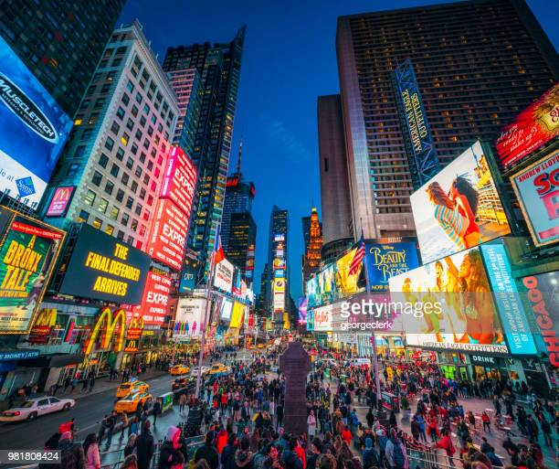 times square in new york city at dusk - broadway manhattan stock photos and pictures