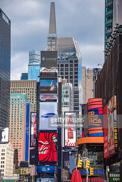 Times Square in New York City Times Square is a major commercial intersection and neighborhood in Midtown Manhattan The landmark is brightly adorned...