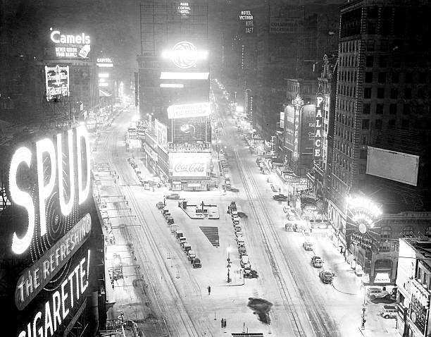 Times Square is covered in a white blanket during snowstorm.