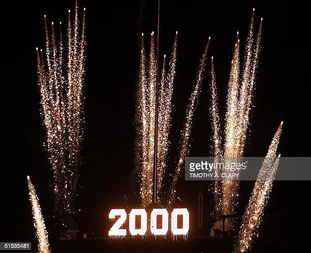 Times Square lights up as the ball drops to light up the 2000 sign as the New Year is celebrated in New York at the Times Square 2000 celebration 01...