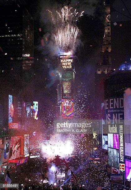 Times Square lights up as the ball drops to light up the 2000 sign as New Years is celebrated in New York at Times Square 01 January 2000 About two...