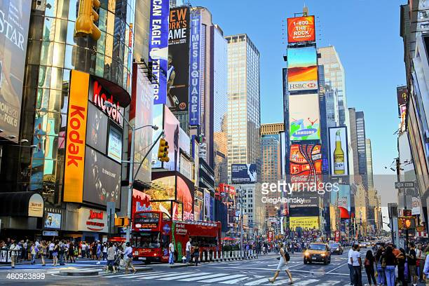 Times Square, Manhattan, New York City, lit by evening sun.