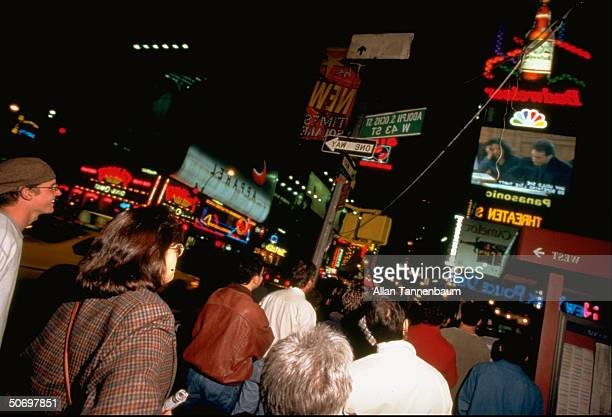 Times Square New York at night w crowds viewing final episode of the TV sitcom Seinfeld on Sony's huge Jumbotron TV
