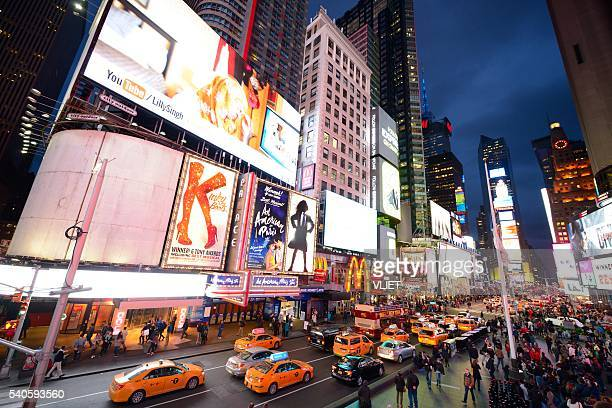 Times Square New York City at night with yellow cabs