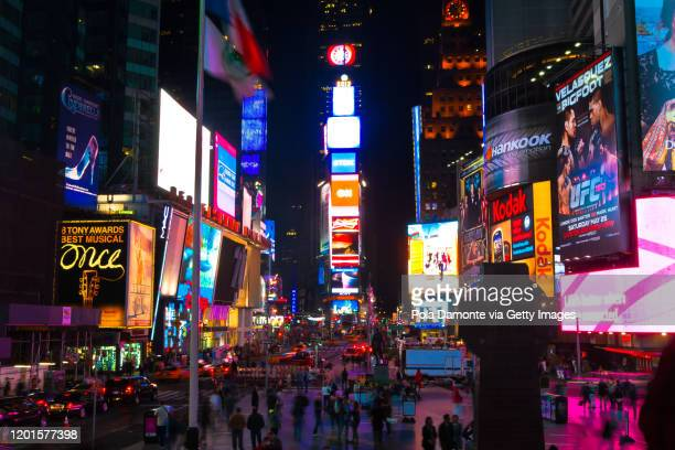 times square night scene, new york, usa - times square manhattan stock pictures, royalty-free photos & images