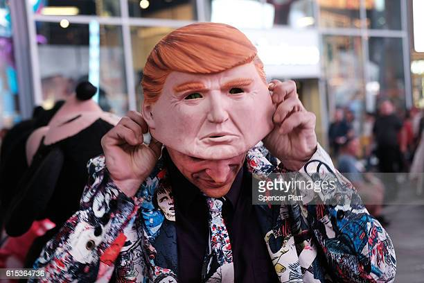 Times Square performer works in a Donald Trump mask on October 17 2016 in New York City As the nation prepares for the final debate between...