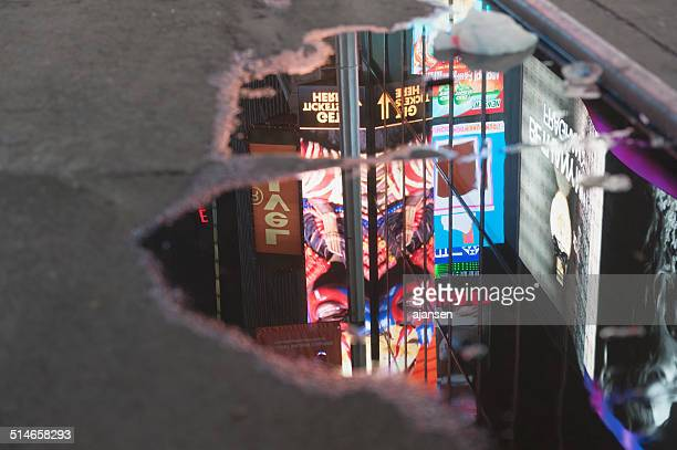 times square reflecting in water