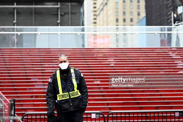 Times Square security guard stands in front of the empty TKTS bleachers amid the coronavirus pandemic on April 05 2020 in New York City COVID19 has...