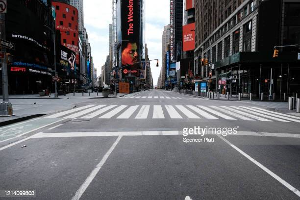 Times Square stands mostly empty as as much of the city is void of cars and pedestrians over fears of spreading the coronavirus on March 22 2020 in...