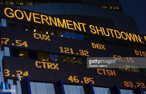 Times Square Stock Ticker displays a sign about governments's shutdown as well as stock exchange values on 1 October 2013 in New York City After...