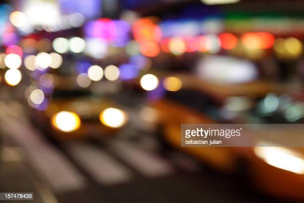 times square streetlife at night defocused