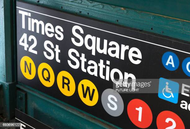 times square subway metro station sign, new york city, usa - new york city subway stock pictures, royalty-free photos & images