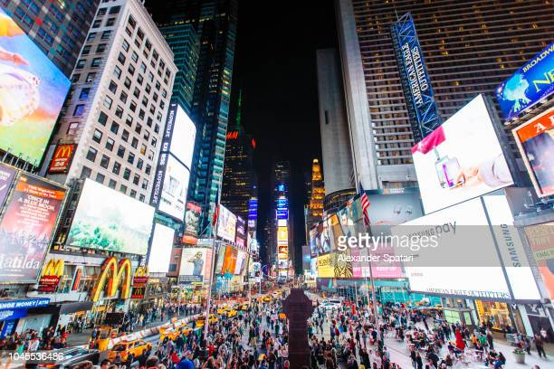 times square with illuminated billboards and advertisement at night, new york city, usa - times square manhattan stock pictures, royalty-free photos & images