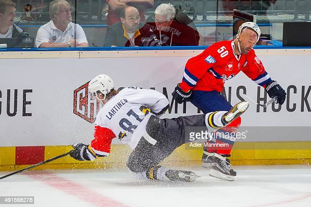 Timi Lahtinen of Espoo Blues in action with Mannheim's Glen Metropolit during the Champions Hockey League round of thirty-two game between Adler...