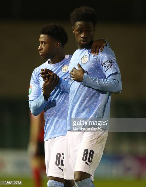 Timi Sobowale of Manchester City U21 and Darko Gyabi of Manchester City U21 look on, after his team lost on penalties during the EFL Trophy match...