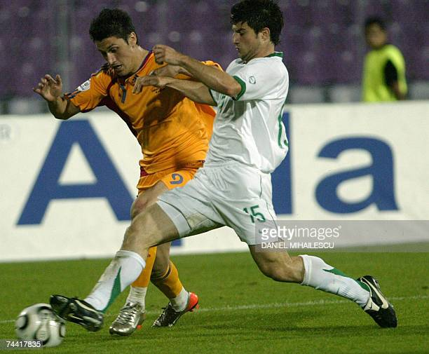 Ciprian Marica from Romania vies for the ball with Slovenia's Bojan Jokic during the EURO 2008 Group G qualifications match in Timisoara city 06 June...