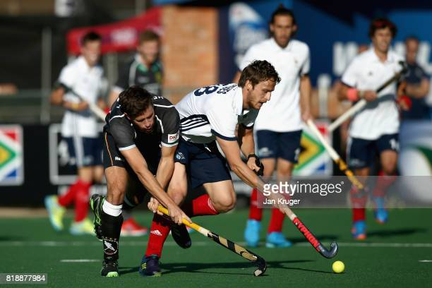 Timm Herzbruch of Germany and JeanBaptiste Forgues of France battle for possession during the Quarter final match between Germany and France during...