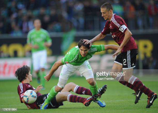 Timm Klose and Timmy Simons of Nuernberg and Srjdan Lakic of Wolfsburg battle for the ball during the Bundesliga match between VfL Wolfsburg and 1....