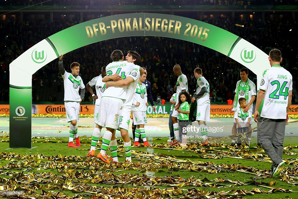 Timm Klose (R) hugs his teammate Ricardo Rodriguez (L) after the DFB Cup Final match between Borussia Dortmund and VfL Wolfsburg at Olympiastadion on May 30, 2015 in Berlin, Germany