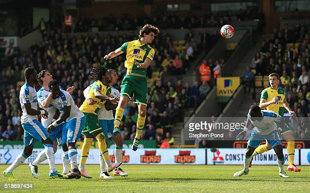 Timm Klose of Norwich City heads the ball to score his team's first goal during the Barclays Premier League match between Norwich City and Newcastle...