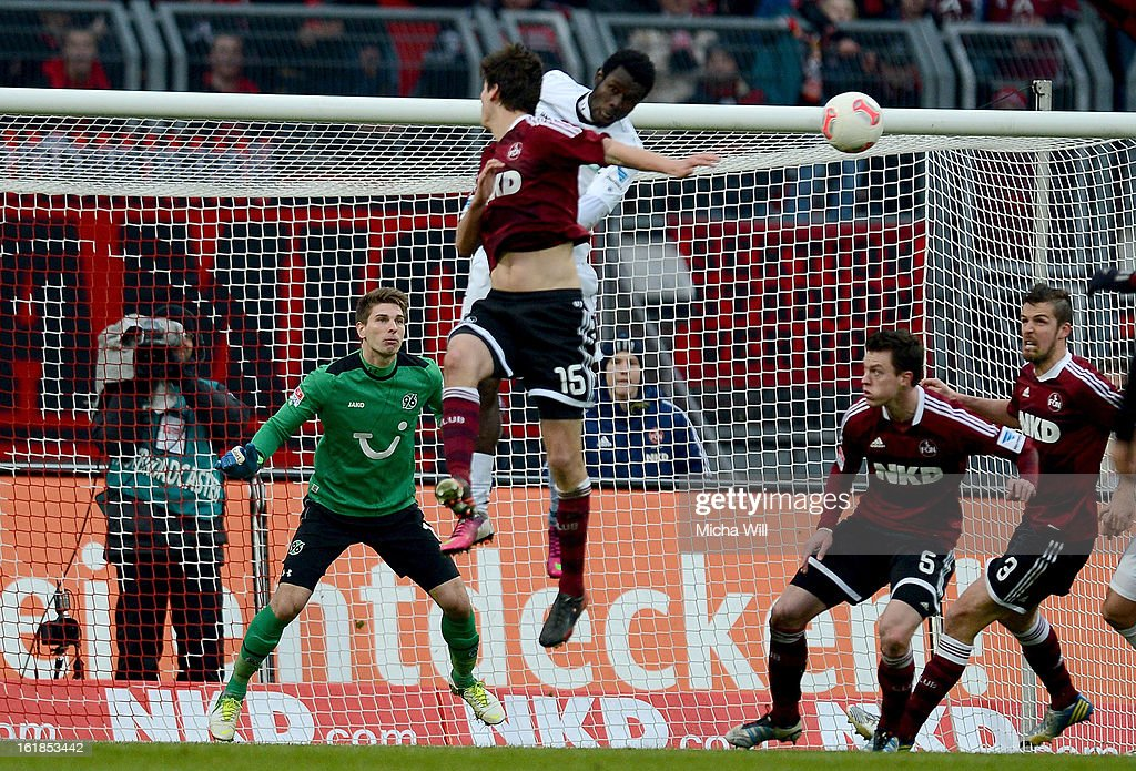 Timm Klose #15 of Nuernberg heads in the ball past Hannover goalkeeper Ron-Robert Zieler to score his team's first goal to equalise during the Bundesliga match between 1. FC Nuernberg and Hannover 96 at Grundig-Stadion on February 17, 2013 in Nuremberg, Germany.