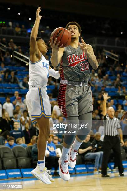 Timmy Allen of the Utah Utes goes up for a layup as Jaylen Hands of the UCLA Bruins attempts to block during the first half of a game at Pauley...