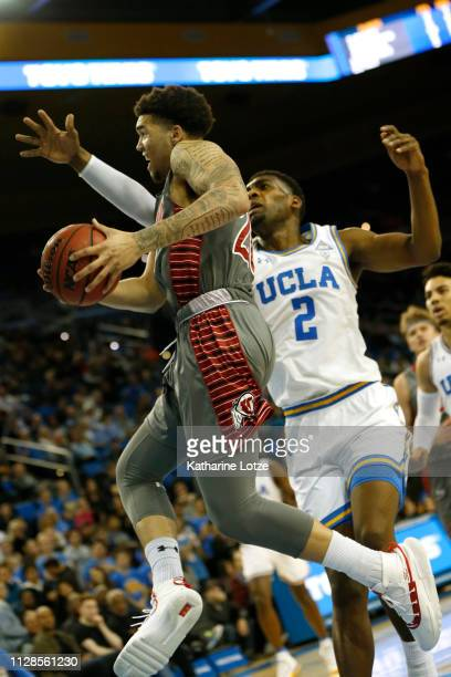 Timmy Allen of the Utah Utes goes up for a shot as Cody Riley of the UCLA Bruins tries to block during the first half of a game at Pauley Pavilion on...